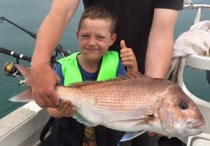Banjo Hilton 6, looking pleased with the snapper he caught off Clifton Springs.
