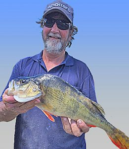 Basil Wentworth with a 1.3 kg redfin from Lake Purrumbete (Picture John Clements).