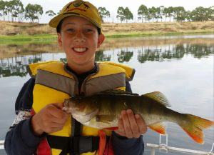 Lachlan Grove with his Monday morning's redfin from Lake Purrumbete (Picture John Clements). .