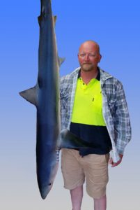 Matt Tattersall with a blue shark that he and Justin Latter caught offshore from Barwon Heads last week.