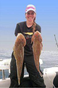 Keryn Millard with a pair of the big flathead that she and her father Dean caught on the drift off Portland (Picture: Dean Millard).