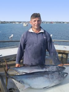 Tom Ninevicxs with his catch of tuna from Julia Reef, east of the Portland Harbour in 23 metres of water (Picture: Bob McPherson).
