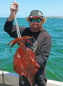 Aaron Habgood with one of the squid he caught off Queenscliff at the weekend (Picture: Aaron Habgood).