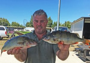 John Clements with a sample of the redfin from Lake Purrumbete (Picture: Lake Purrumbete Holiday Park).