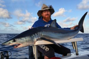 Paul Carson with the mako shark that was taken at night 70 km offshore from Warrnambool (Picture: Kevin McLoughlin).