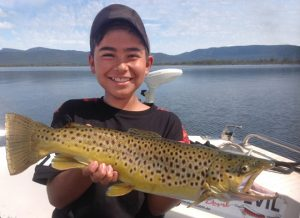Luis Elgueta junior with his brown trout from Lake Fyans (Picture: Victorian Inland Charters).