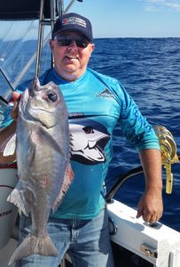 Michael Golby with yet another blue eye trevalla (Picture: Bob McPherson).