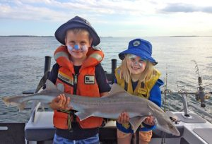 Henry and Sophia Jankowski with the gummy shark they caught near the West Channel (Picture: Warren Jankowski).