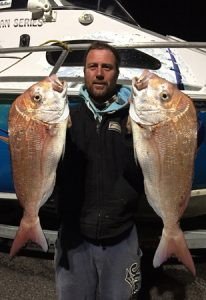Matt Kincaid with two of the four snapper that he and Danny Skene caught off Point Richards in Port Phillip Bay on Thursday night (Picture: Danny Skene).
