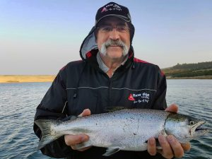 Well taken: Cricket legend Merv Hughes with a nice chinook salmon from Lake Bullen Merri (Picture: Victorian Inland Charters).