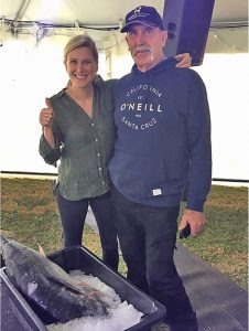 Portland angler, Bob McPherson, of gets some hands-on instruction from Master Chief star Justine Schofield on preparing the catch.