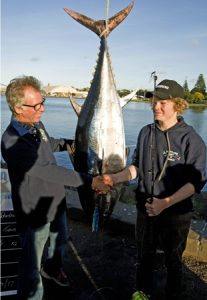 Legendary lure maker, Peter Pakula, congratulates fifteen year old Hugh Johnstone on the capture of a 60 kg bluefin on a Pakula lure at Portland (Picture Bob McPherson).