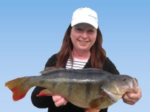 Natalie Holmes with the 2.58 kg redfin she caught from ... Well husband Trevor won't let her say, so your guess is as good as mine (Picture: Victorian Inland Charters).