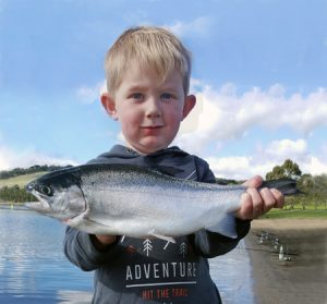 Young blood: Three year old Billy Andrews with a 1.4 kg rainbow trout that he caught from Lake Bullen Merri (Picture: Brad Andrews).