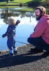 Learning the trade: Michael Redpath with his 18 month old grandson Jaxon, fishing for carp in Seagull Paddock, North Geelong (Picture: Liffy Jennings).