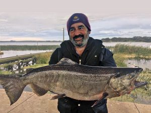 Anthony Webb with the chinook salmon he caught from Lake Purrumbete