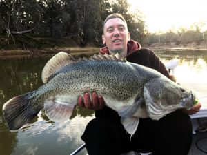 Justin Burns with his 95 cm Murray cod from the Murray River near Echuca. (Picture: Simon Williams).