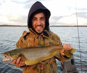 Anthony D'Agostino with the brown trout he caught from Lake Bullen Merri and then released (Picture: Tony D'Agostino).
