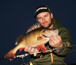 Michael Evans with a sample of his redfin catch from Wurdiboluc Reservoir on Sunday night (Picture Michael Evans).