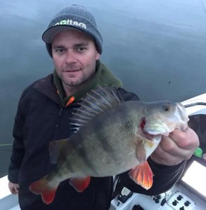 Michael Evans with a nice redfin taken on a Fish Arrow Soft Plastic (Picture: Victorian Inland Charters).