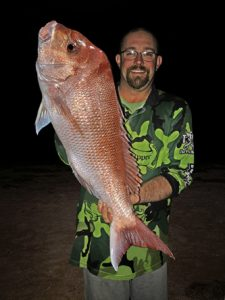 On the beach: Danny Skene with the 7.4 kg snapper he from the beach at Indented Head last week.