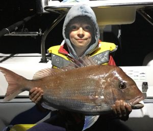 Cody Formosa with one of the snapper that he and his father John caught offshore from Point Wilson over the weekend.