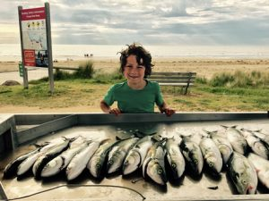 Xavier Lalic with the morning's catch of Australian salmon from the beach at Anglsea (Picture: Kevin McLoughlin).