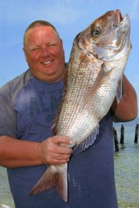 Tickled pink: Dean Hall with his snapper from Corio Bay.