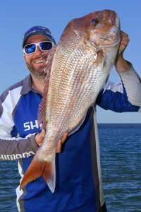 Chris Stamalos with the 7 kg snapper that he caught off Barwon Heads at the weekend.