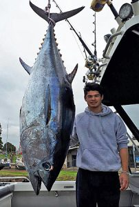 Nigel Ah-Cann with his 125 kg tuna, also taken offshore from Portland (Picture: Bob McPherson).