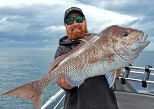 Big Red: Aaron Habgood with yet another big snapper from Corio Bay (Picture: Aaron Habgood).