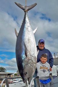 Kevin Agius and his son Korey with the 118 kg tuna they caught offshore from Portland.