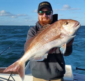 Aaron Habgood of Red's Fishing Adventures with one of several snapper he caught off Clifton Springs last week (Picture: Aaron Habgood).