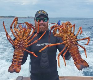 Aaron Habgood with two crayfish he caught by hand (Picture Aaron Habgood).